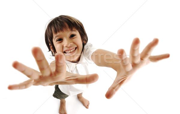 Positive cute kid trying to catch you Stock photo © zurijeta