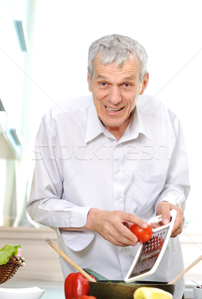 Good looking senior  man working in kitchen Stock photo © zurijeta