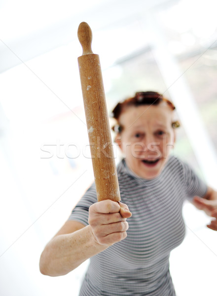 Mérges idősebb nő sodrófa lány arc Stock fotó © zurijeta