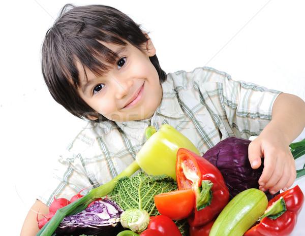 Gyerekek étel mosoly gyermek egészség fiú Stock fotó © zurijeta