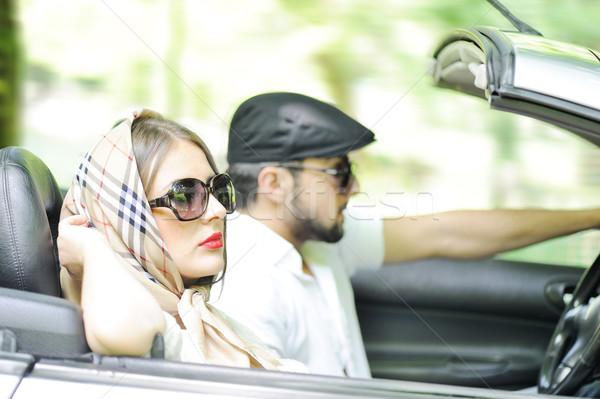 Two happy and sensual caucasian friends having drive on cabriole Stock photo © zurijeta