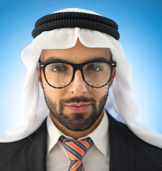 Portrait of attractive Arab man wearing glasses Stock photo © zurijeta