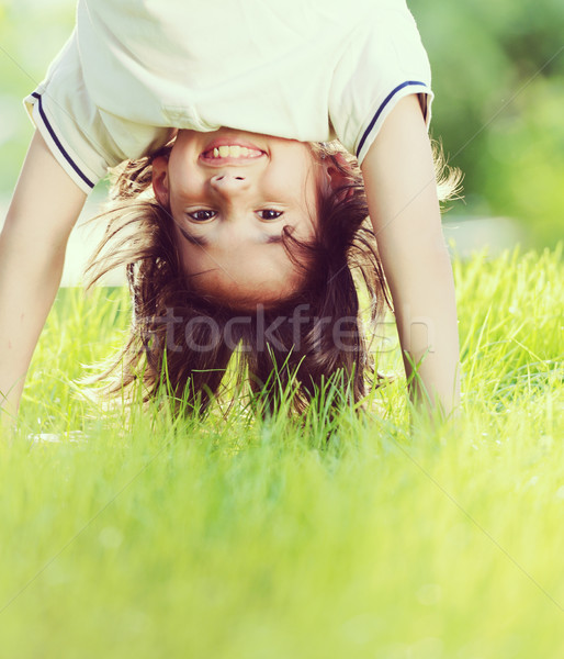 Group of happy children playing outdoors in spring park Stock photo © zurijeta