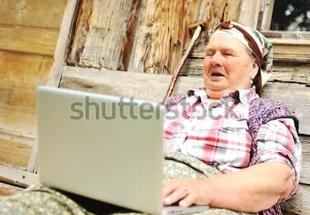 Senior aged woman with laptop Stock photo © zurijeta