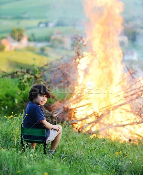 Kid beside the big fire Stock photo © zurijeta