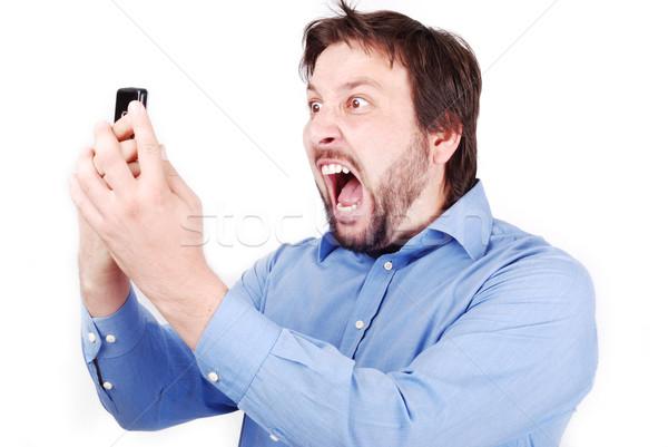 Yelling man on phone Stock photo © zurijeta