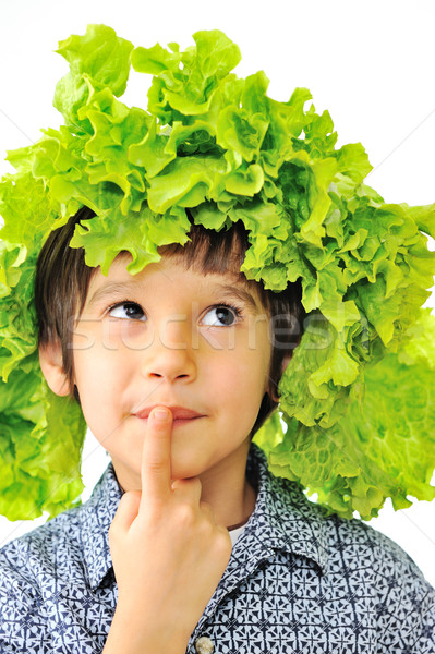 Curious little kid with salad on his head as hat Stock photo © zurijeta