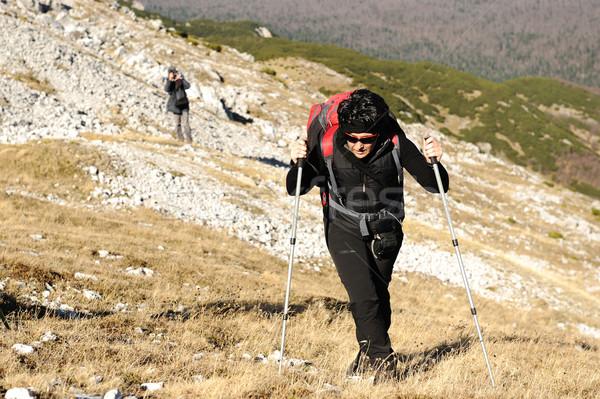 Montagna donna cielo uomo sport natura Foto d'archivio © zurijeta