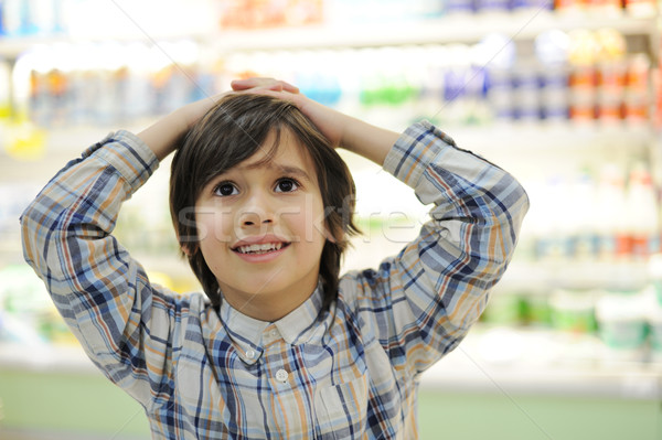 Kid with hands on his head in shopping mall Stock photo © zurijeta