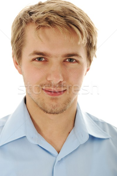 Portrait of an handsome blond man wearing a shirt looking at cam Stock photo © zurijeta