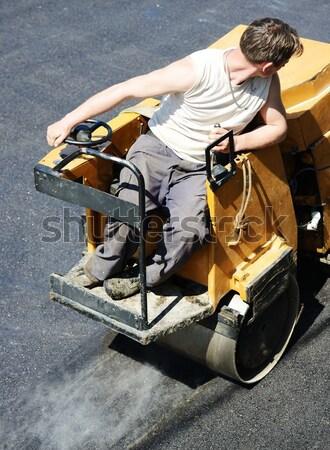 Duro lavoro asfalto costruzione uomini guida strada Foto d'archivio © zurijeta