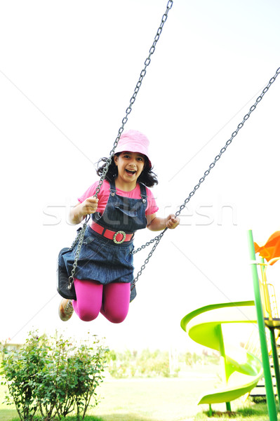 Aire de jeux fille nature enfant rouge Kid Photo stock © zurijeta