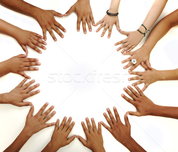 Conceptual symbol of multiracial children  hands making a circle on white background with a copy spa Stock photo © zurijeta