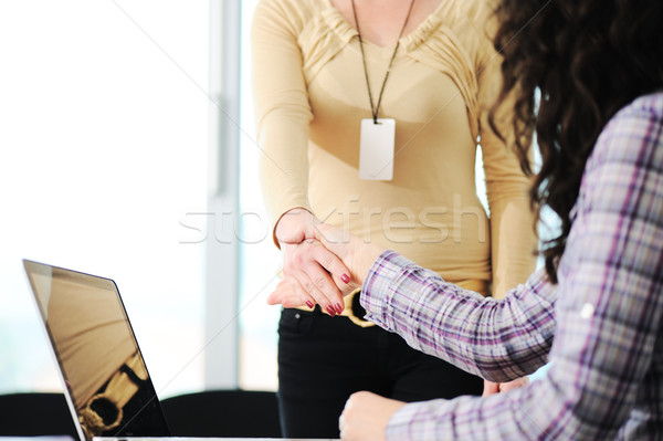 Closing a successful deal with woman  handshake. Congratulations!  Stock photo © zurijeta