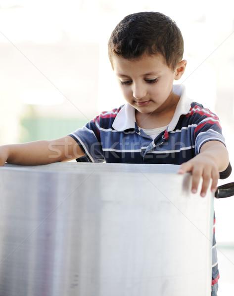 Portrait of poverty, little poor boy on food pot Stock photo © zurijeta