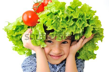 Kid with salad and tomato hat on his head, fake hair made of vegetables  Stock photo © zurijeta