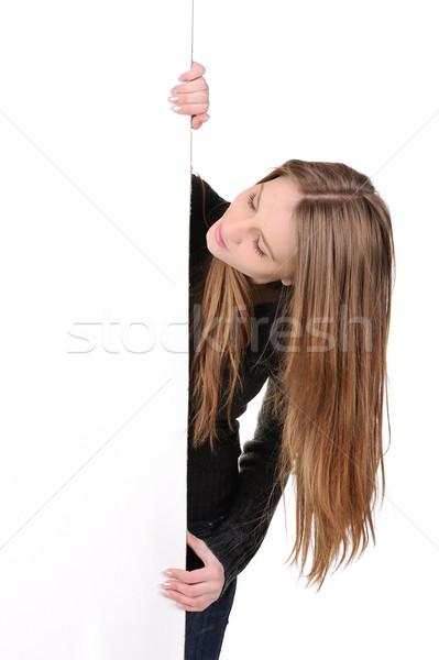 Gyönyörű fiatal nő tart plakát papír lány Stock fotó © zurijeta