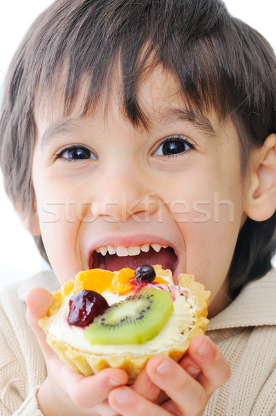 Cute little kid trying out delicous cake Stock photo © zurijeta