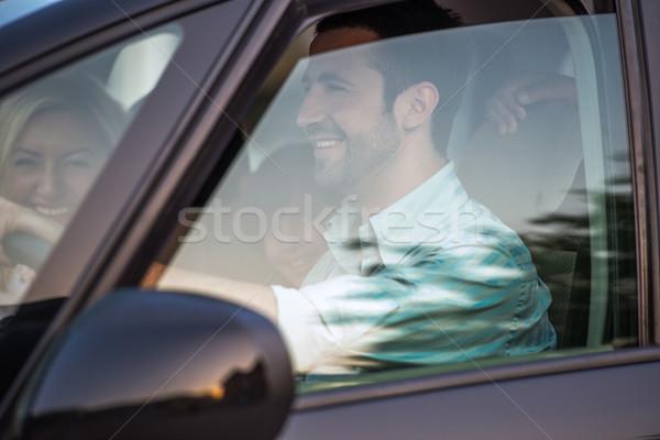 улыбаясь пару автомобилей за пределами мнение вождения Сток-фото © zurijeta