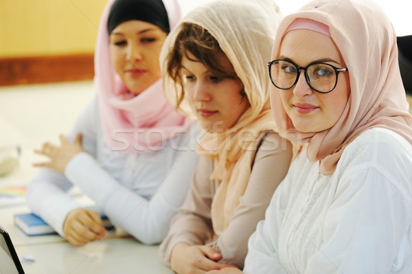 Casual group of students looking happy and smiling Stock photo © zurijeta