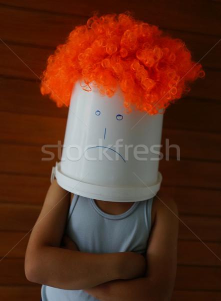 Angry boy with bin on his head Stock photo © zurijeta