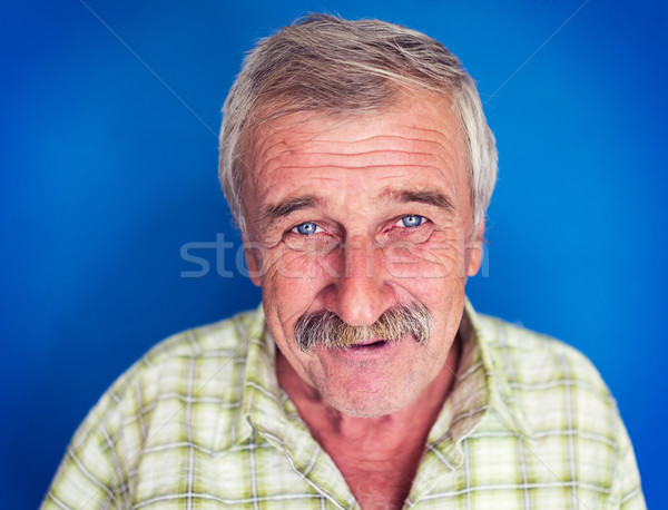 Smiling and confident mature man with mustache, wrinkles and gre Stock photo © zurijeta