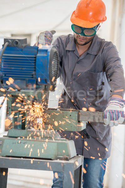 Worker welding in industrial background at factory Stock photo © zurijeta