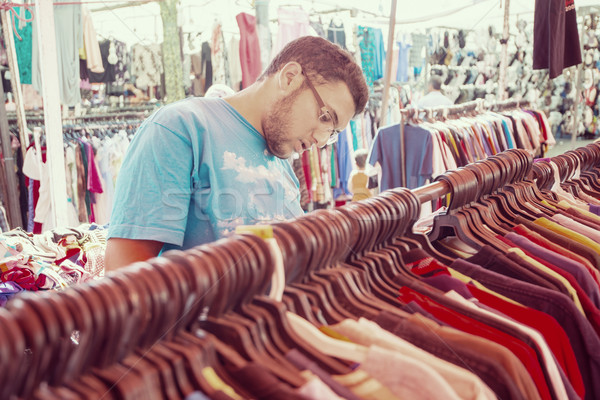 Young man buying in second hand store Stock photo © zurijeta