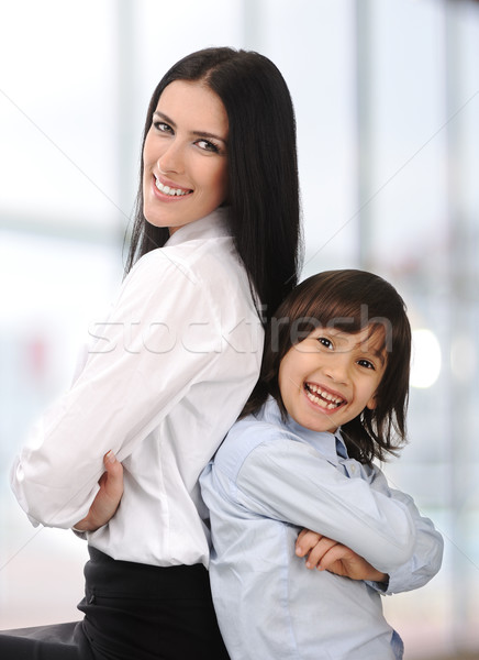 Young mother and son standing together, back to back indoor Stock photo © zurijeta