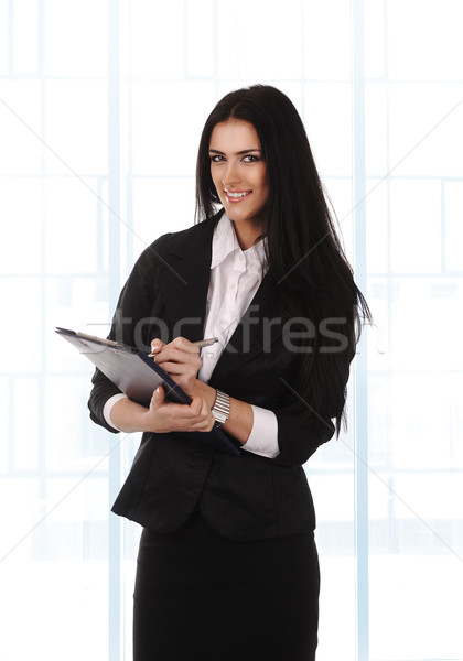 Beautiful business woman is working at the office Stock photo © zurijeta