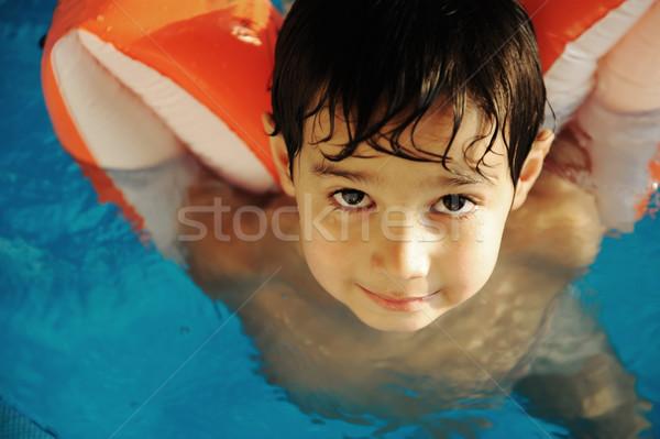 Gyermek fiú medence víz gyerek nevetés Stock fotó © zurijeta