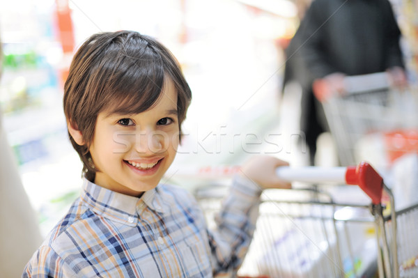 Boy holding cart in shopping mall Stock photo © zurijeta
