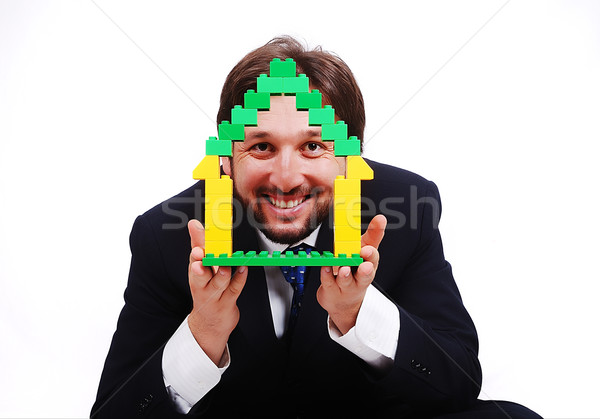Young male holding homes made by cubes Stock photo © zurijeta