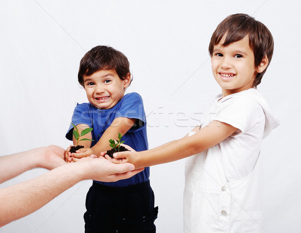 Save our earth, two boys with plant in hands Stock photo © zurijeta