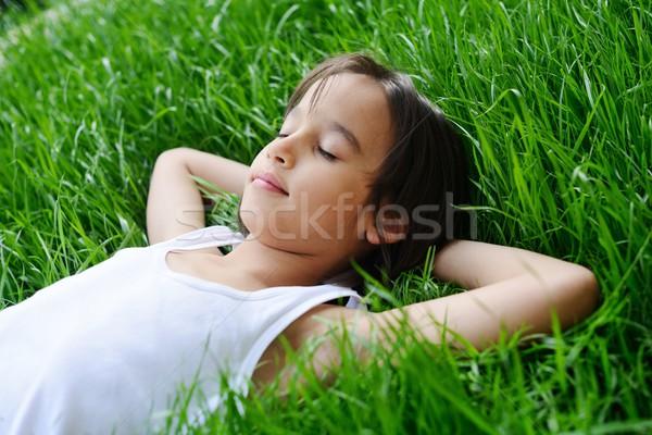 Mutlu küçük erkek çim alanı Stok fotoğraf © zurijeta