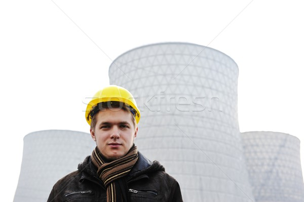 Engineer with protective helmet standing in front of nuclear pow Stock photo © zurijeta