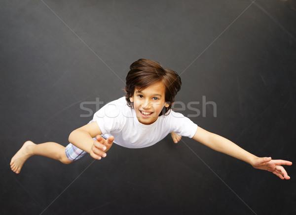 Kid jumping high up Stock photo © zurijeta