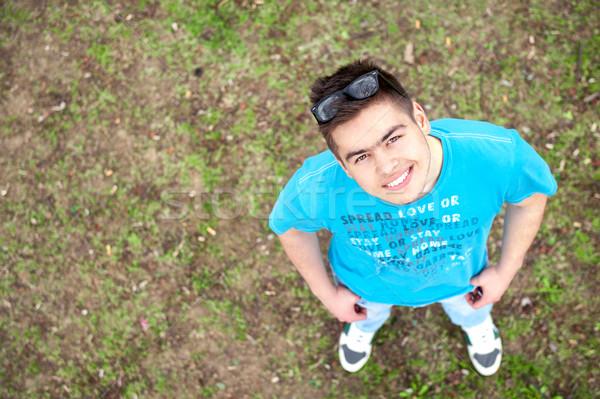 Happy teenager looking upwards Stock photo © zurijeta