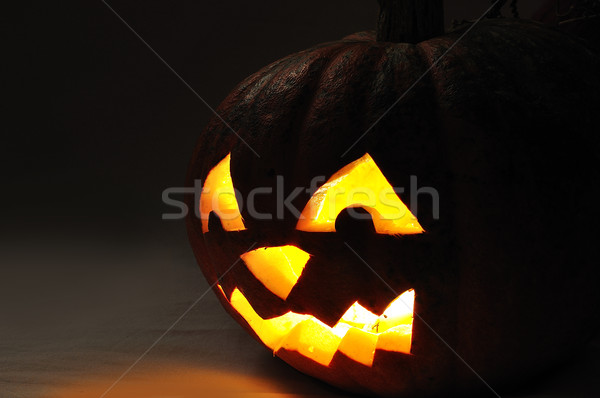 The carved face of pumpkin glowing on Halloween Stock photo © zurijeta