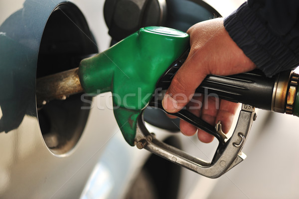 Człowiek samochodu paliwa stacja benzynowa działalności oleju Zdjęcia stock © zurijeta