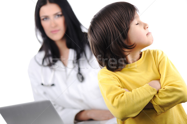 Young female doctor examining little cute angry child refusing examining Stock photo © zurijeta