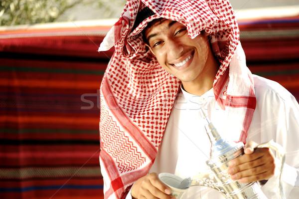 Young man with original traditional coffee Stock photo © zurijeta