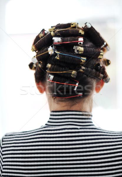 Woman with curlers on head, back Stock photo © zurijeta
