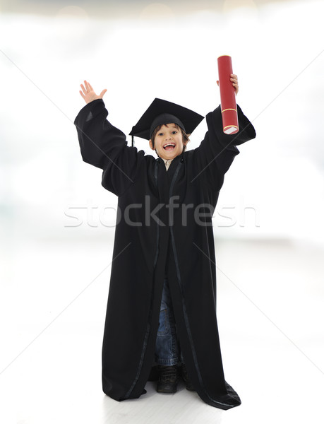 Happy successful kid with diploma and graduating clothes Stock photo © zurijeta