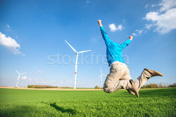 Man jumping on wind farm Stock photo © zurijeta