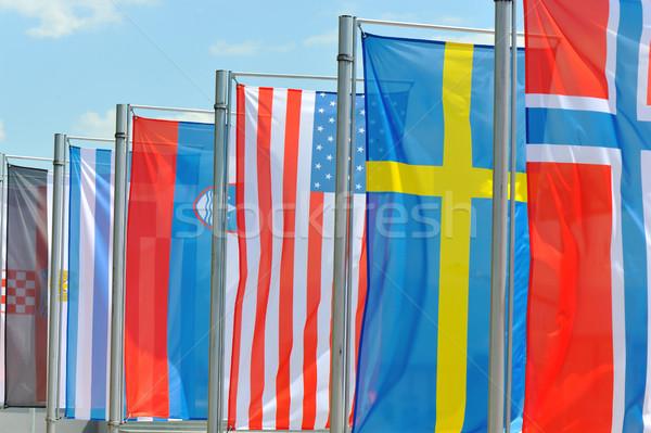 Zászló szél kék ázsiai Európa afrikai Stock fotó © zurijeta