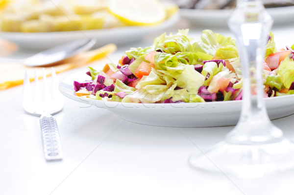 Fresh green salad prepared on white meal table Stock photo © zurijeta