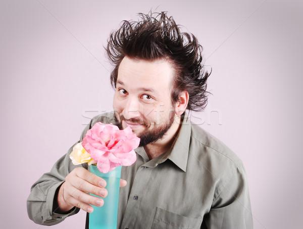Crazy молодые бизнесмен бизнеса цветок Сток-фото © zurijeta