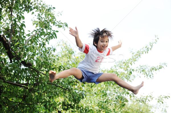 Jumping kid in the air  Stock photo © zurijeta