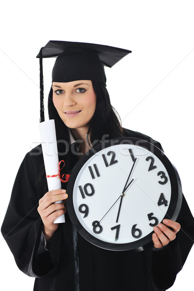 Graduate girl student in gown with diploma and clock Stock photo © zurijeta
